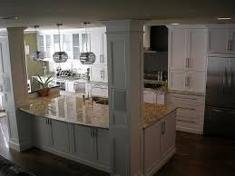 kitchen island with posts view of kitchen from stairs columns kitchens and house
