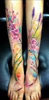 colorful cool flower tattoo on calf and foot golfian com