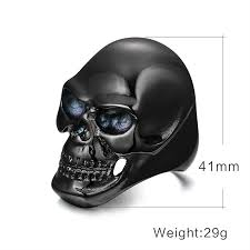 big and scary skull ring in black and gold wowrings
