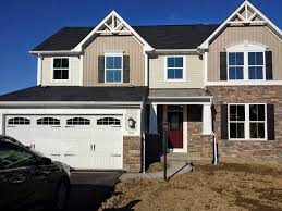 decor ryan homes venice with stone siding and gabled roof for