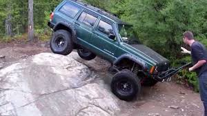 cartoon jeep cherokee jeep cherokee gets on 3 wheels and guy pushes it back over youtube