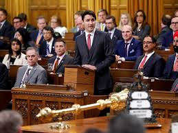 justin trudeau apologizes for getting physical with lawmakers in