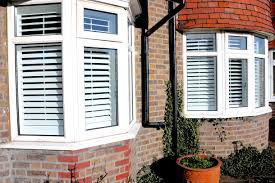 fitting shutters for bay windows everything you need to know full height basswood shutters with centre tilt road fitted in surrey