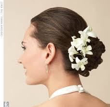 flowers for hair white dendrobium orchid heads are pinned onto one side of this