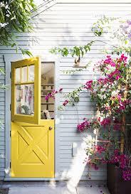 back dutch door in yellow color house with the dutch doors