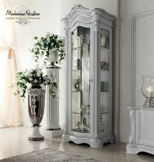 how to decorate glass cabinets in living room ivory sitting room with impero style furniture and silver leaf one