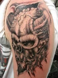 ripped skin skull on shoulder tattooshunt com