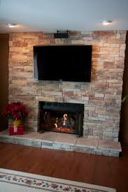 ledge stone fireplace with tv located in lake zurich stone was