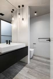 black and white bathroom design this mostly white bathroom with a black vanity has simple pendant