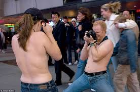 bare breasted women celebrate going posing for photographer on new york