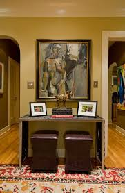 sherwin williams restrained gold hall eclectic with area rug
