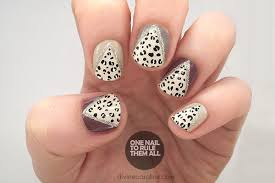 feeling frisky try this glam glitter and leopard print nail
