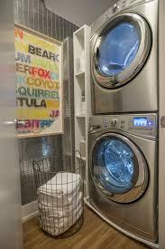 Laundry Room Storage Between Washer And Dryer by Stacked Washer Dryer Speedqueen Ltsa7 Stacked Washerdryer Top