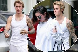 justin bieber shows big muscles and tattoos off after couples