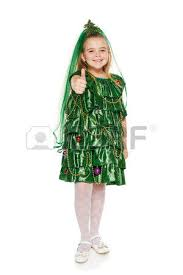 funny 7 years old in christmas tree costume feeling happy