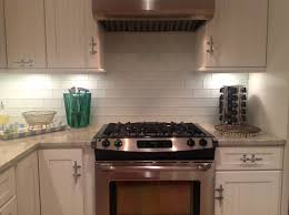 subway tile kitchen dark cabinets l shape light brown wood cabinet