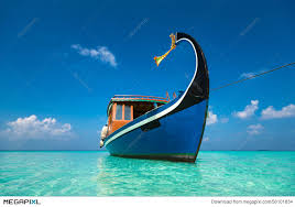 tropical island paradise perfect tropical island paradise beach and boat stock photo