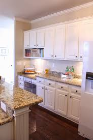 antique white cabinets with clipped corners on the bump out sink