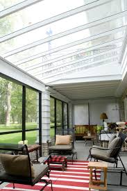 polycarbonate greenhouse sunroom traditional with area rug