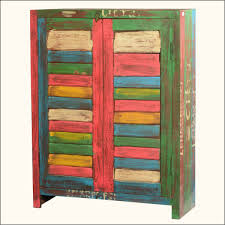 small reclaimed wood storage cabinet with stained shutter doors of