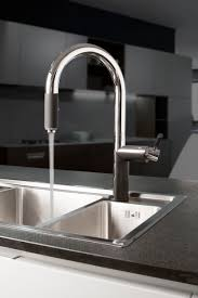 cleaning kitchen faucet the strong and sturdy oscar kitchen faucet makes cleaning up easy