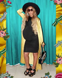 pregnant beyoncé is giving lemonade vibes in new maternity style shoot