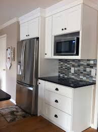 microwave shelf dark quartz with white cabinets stainless