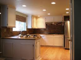 Painted And Glazed Kitchen Cabinets by How To Paint Cream Kitchen Cabinets With A Glaze Decoration
