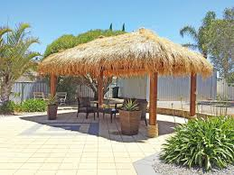backyard living with thatched roof gazebo aarons outdoor living