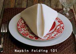 how to make fancy table napkins how to fold a dinner napkin the pyramid fold