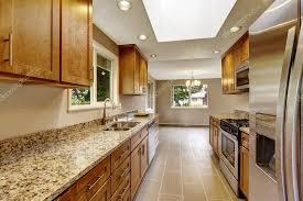 modern kitchen with brown cabinets modern kitchen room with matte brown cabinets shiny granite tops 115595756