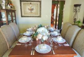 budget ideas tablescapes at table 21 notice the use of translucent stemware and votive holders that keep the table light the home