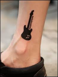 black guitar tattoo on ankle