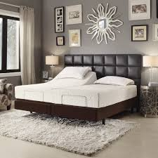 rectangle black leather headboard with brown wooden bed having