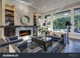 Grey Tile Living Room by Chic Living Room Filled Builtin Cabinets Stock Photo 564983497