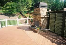 stone outdoor fireplace on low maintenance deck archadeck