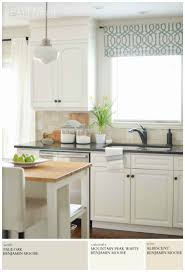 modern farmhouse neutral paint colors a burst of beautiful a modern farmhouse kitchen is painted light grey pale oak by benjamin moore for