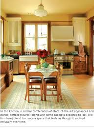 pale wood floors mixed cabinets built in bench stainless