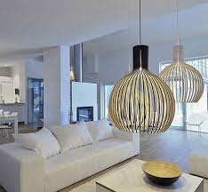 Modern Pendant Light Fixtures by Cage Shaped Modern Pendant Lighting Fixtures Over A White Living