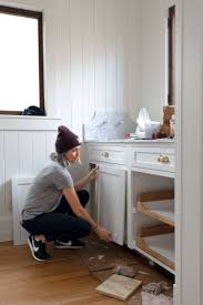 how to paint existing kitchen cabinets diy how to paint cabinets by an update on our