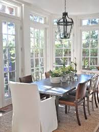 sunroom dining room sun room layout ideas brown wooden dining table madison porcelain