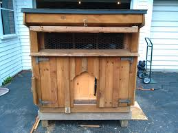 small chicken chicken coop with large front window open