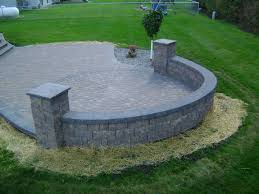 paver patio edging earth tone paver patio with sitting wall and rock fill edging
