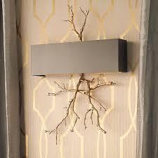 sculptural twig wall sconce a sculptural branch in golden brass