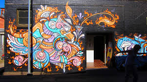 pics photos colorful abstract graffiti wall murals painting and a happy graffiti phoenix smiles at all who enter in this street art mural by phibs