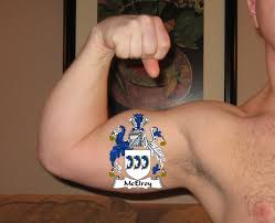 superwhizbang local man tattoos family crest on bicep as a