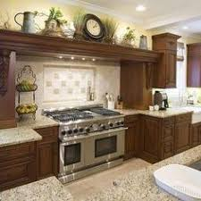 ideas for tops of kitchen cabinets 62 best decorating above kitchen cabinets images on
