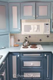 how to paint melamine kitchen cabinets dark colors light colors