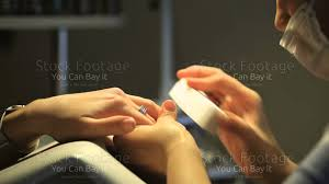 manicure and hands spa woman in a beauty nail salon receiving a