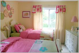 ultimate shared toddler girls bedroom idea with tan wall paint